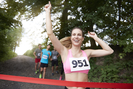 finishing line: Woman first on the finishing line