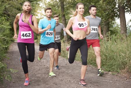 rival rivals rivalry season: Jogging marathon in the forest Stock Photo