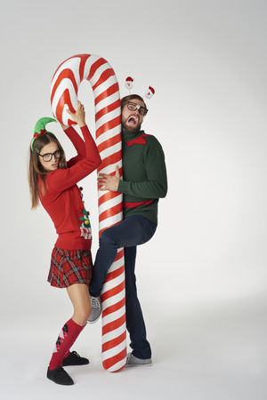 Funny Christmas couple with candy cane