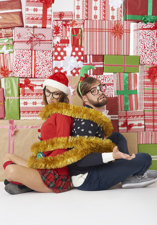 Wall of gifts and couple wrapped with golden chain