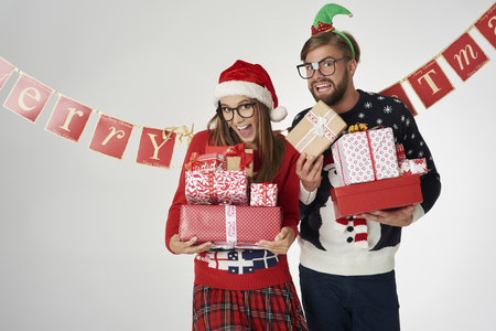 Couple holding Christmas presents in hands Stock Photo