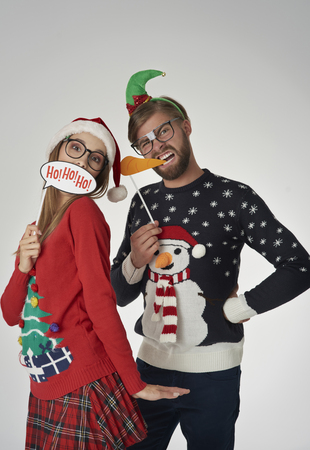 Cheerful couple with funny masks