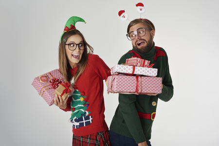 glasses eye: Christmas couple exchanging the presents Stock Photo