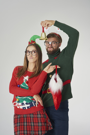 Couple posing with bell and Christmas sock Stock Photo