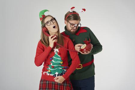 Christmas couple calling by retro telephone