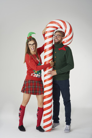 Couple posing with a huge candy cane