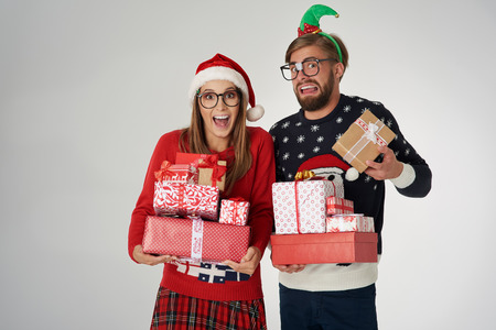 Heavy Christmas presents in couple's hands Stock Photo