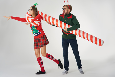 Man catching his girlfriend with a candy cane
