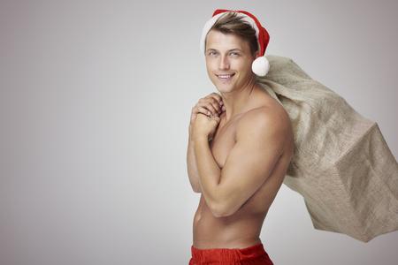 sexy santa claus: Big sack and sexy Santa Claus Stock Photo