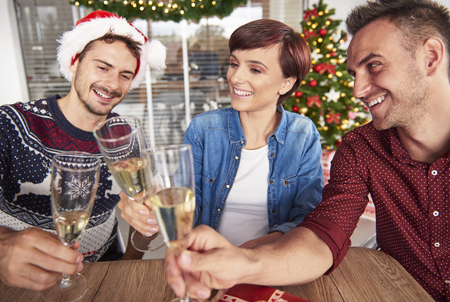 successes: Cheerful start up team toasting for more successes Stock Photo