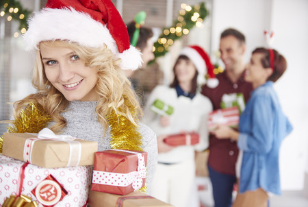 handing over: One of team coworkers is handing over Christmas presents Stock Photo