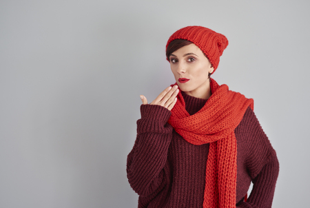 Shy woman in winter clothes