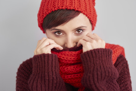 warm clothes: Woman hiding in warm clothes