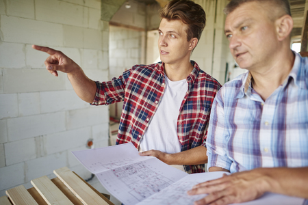 resolving: Younger carpenter has got an idea and vision Stock Photo