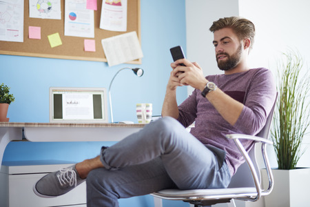 mobilephone: Man texting with his mobilephone