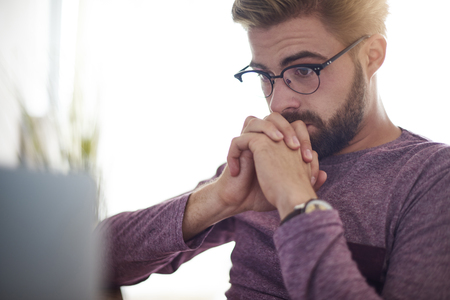 casual office: Busy man waiting for something important Stock Photo