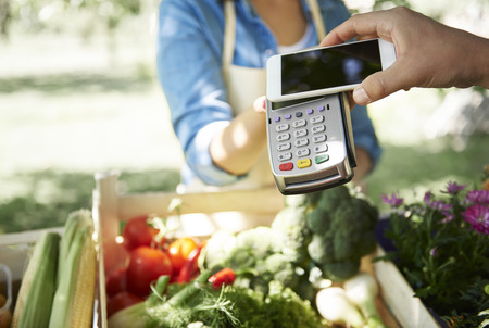 Credit card payment on the farmers shop Stock Photo