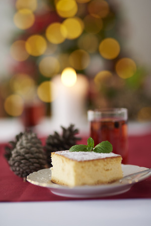 Cheesecake and Christmas tree in the background