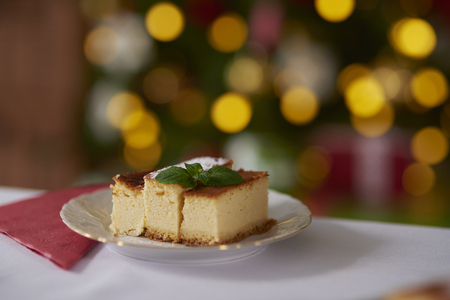 Cheesecake decorated with a mint leaf Stock Photo
