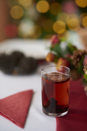 compote: Glass of compote on Christmas table Stock Photo