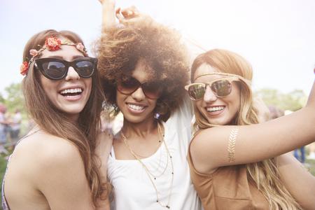 Three of girls spending time togheter in festival