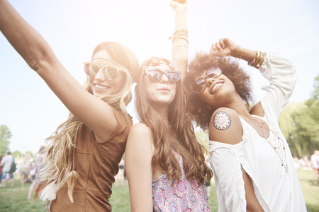 Three best friends at the music festival Stock Photo