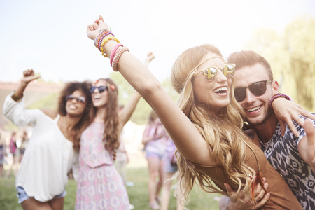 Young and cheerful couple in music festival