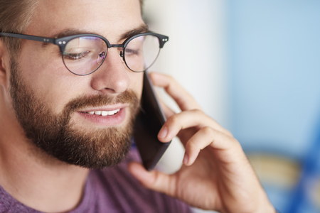mobilephone: Close of a man who uses mobilephone