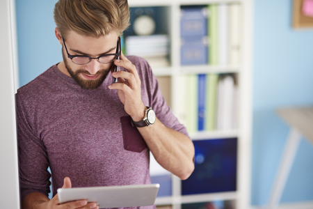multi tasking: Using mobilephone and digital tablet