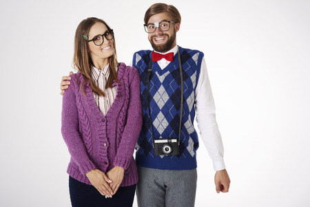 Smiley and happy faces of geek couple Stock Photo