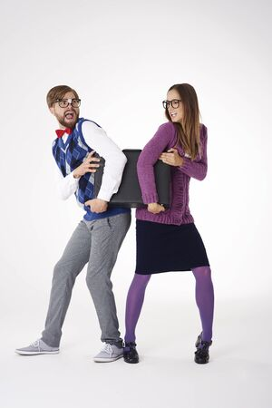grabbing at the back: Couple trying to take the briefcase back