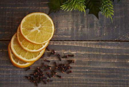 lemon slices: Lemon slices and cloves on wooden table