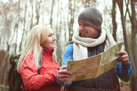 Couple using paper map while hiking