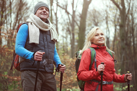 Low angle view of hiking mature couple Stock Photo