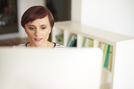 one adult only: Woman looking at computer screen