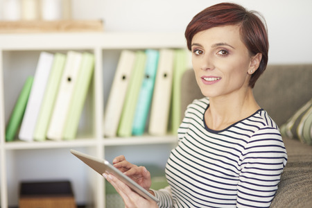 Portrait of woman holding digital tablet Stock Photo