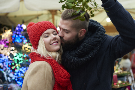 tradition: Kissing under the mistletoe is a tradition