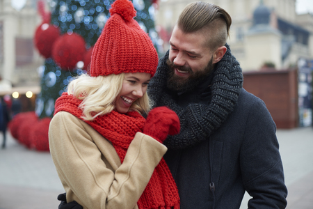 Couple spending funny time at the Chistmas market