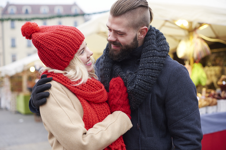 christmas market: Couple embracing on christmas market