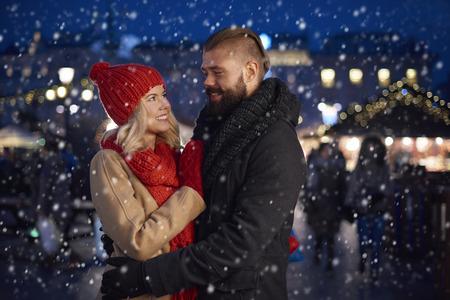 couples hug: Romantic moment in the snow Stock Photo