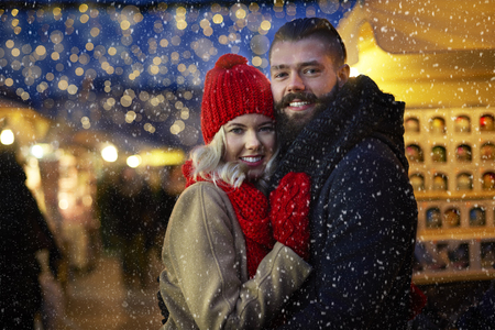 couple outdoor: Man and woman surrounded with snowflakes Stock Photo