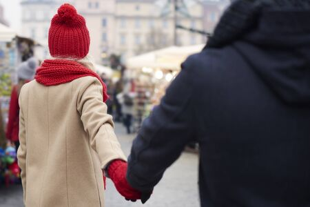 Couple walking hand by hand