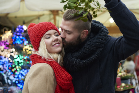 Kissing under the mistletoe is a tradition Stock Photo - 66189556