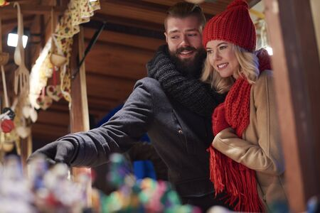 Couple spending time on christmas market Stock Photo