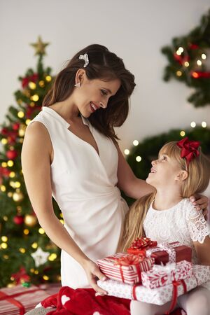 bestowing: Mother sharing with daughter presents Stock Photo