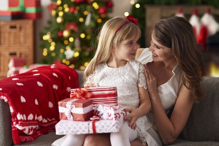bestowing: Daughter sitting on mothers lap Stock Photo