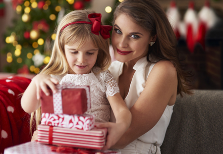 Little girl is bestowing by mother Stock Photo