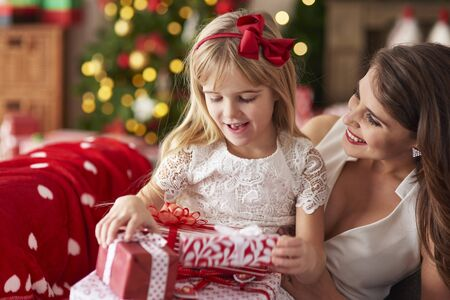 bestowing: Mother bestowing daughter by plenty of presents