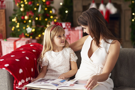 one parent: One of parent reading to daughter Stock Photo