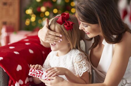 bestowing: Mummy surprising daughter by giving presents